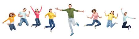 幸福、自由、動き、人々 のコンセプト - 白い背景の上の空気中のジャンプ若い国際的な友達の笑顔 写真素材