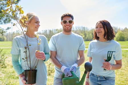 group of volunteers with tree seedlings in park Stock Photo