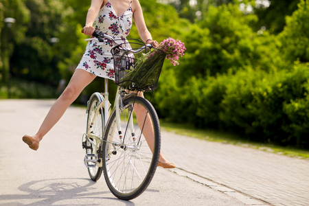 road bike: happy woman riding fixie bicycle in summer park