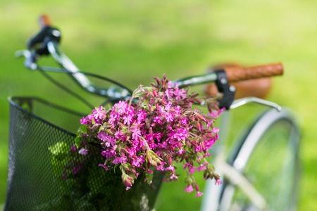 close up of fixie bicycle with flowers in basket