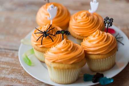 celebration: halloween party decorated cupcakes on plate