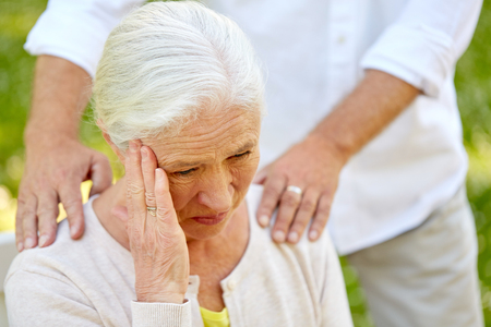 close up of senior woman suffering from headache Stock Photo