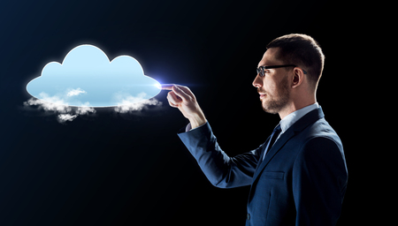 businessman working with virtual cloud hologram Stock Photo