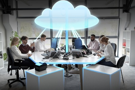 cloud computing, future technology and people concept - business team with computers working at office