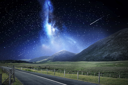 night landscape of road and mountains over space