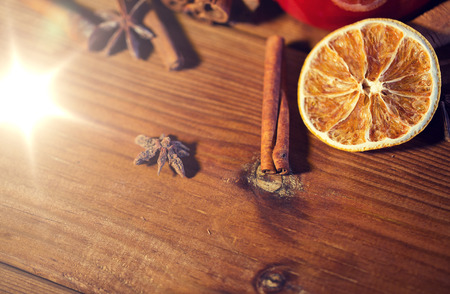 cinnamon, anise and dried orange on wooden board