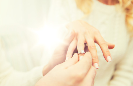 close up of man giving diamond ring to woman Stock Photo