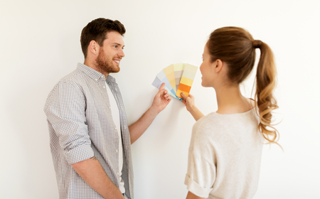happy couple with color samples at new home