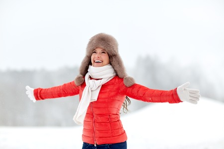 winter fashion: happy woman in winter fur hat outdoors Stock Photo