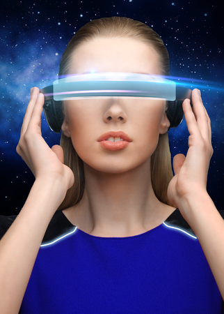 woman in virtual reality 3d glasses over black