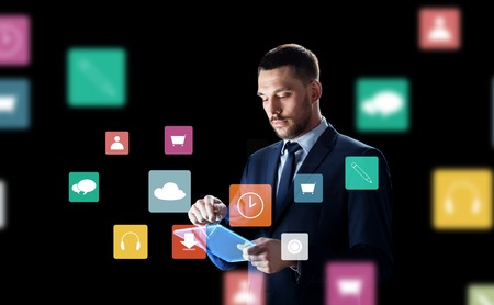 businessman with tablet pc and virtual menu icons