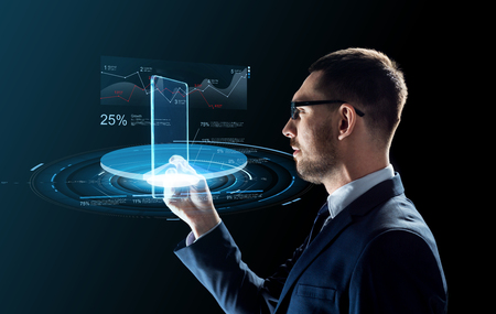 businessman with tablet pc and virtual charts