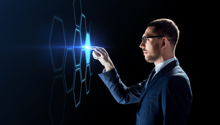 businessman working with virtual network hologram