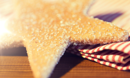close up of star gingerbread cookie and towel Banque d'images