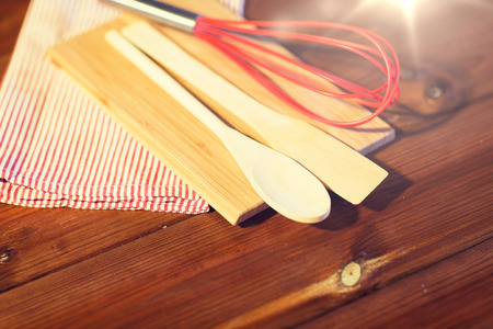 close up of cooking kitchenware on wooden board