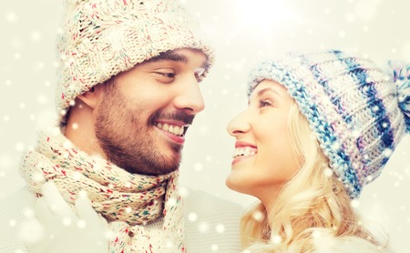 winter fashion: smiling couple in winter clothes hugging Stock Photo