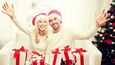 happy couple at home with christmas gift boxes Banque d'images