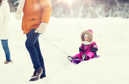 happy family with sled walking in winter forest Banque d'images