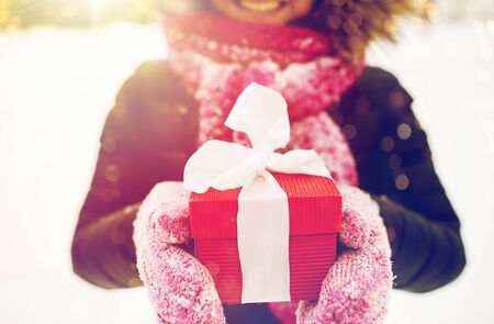 close up of woman with christmas gift outdoors Stock fotó