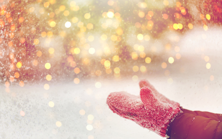 close up of woman throwing snow outdoors