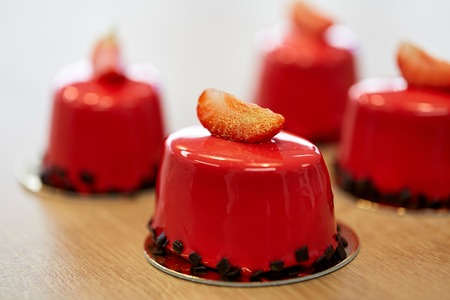 strawberry mirror glaze cakes at confectionery Stock Photo