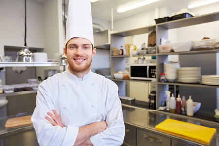 happy male chef cook at restaurant kitchen Stock Photo