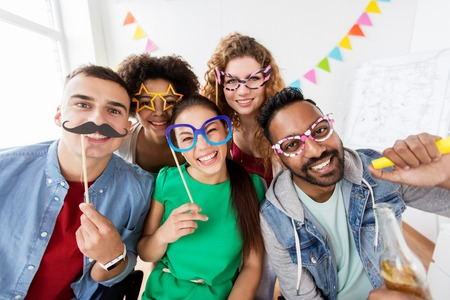 happy friends or team having fun at office party Stock Photo - 86087842