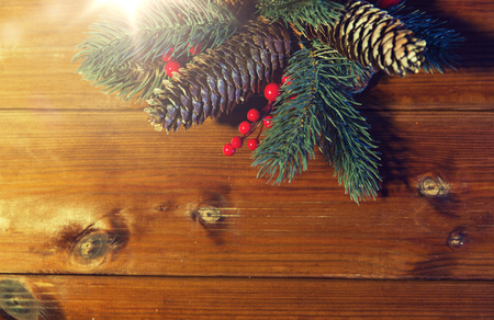 close up of fir branch with cones on wooden table Banco de Imagens