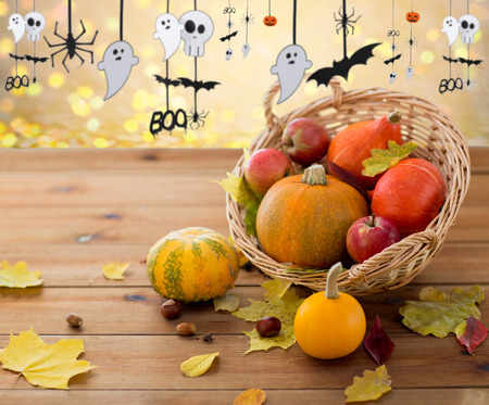 pumpkins in basket and halloween party garland