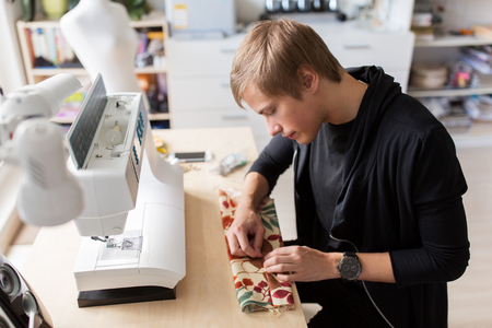 fashion designer with making dress at studio
