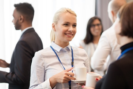 delegation: business people with conference badges and coffee