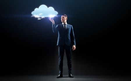business, people, augmented reality and future technology concept - businessman working with virtual cloud hologram over black background