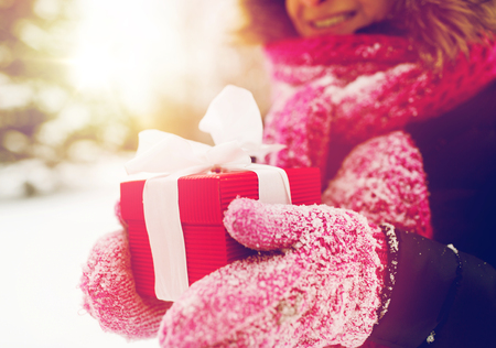 winter holidays, christmas and people concept - close up of happy woman with present or gift box outdoors Reklamní fotografie