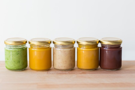 vegetable or fruit puree or baby food in jars Фото со стока