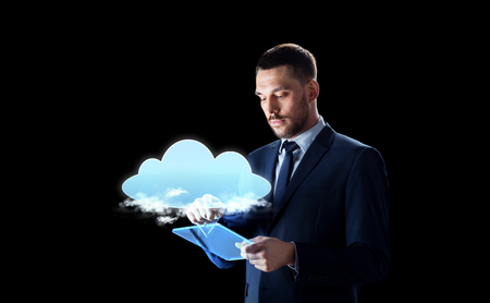 businessman with tablet pc and cloud hologram Stock Photo