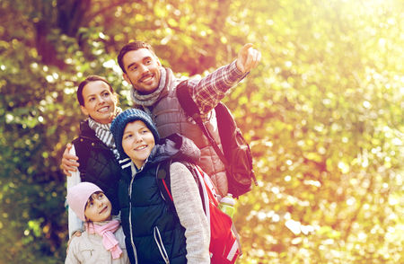 happy family with backpacks hiking 스톡 콘텐츠