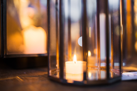 close up of lantern with candle burning inside Stock Photo