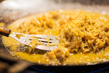 braised cabbage or sauerkraut in wok or frying pan