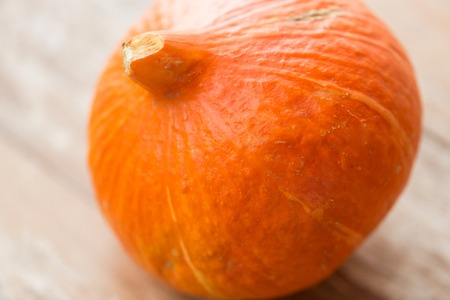 close up of pumpkin on wooden table Stock Photo