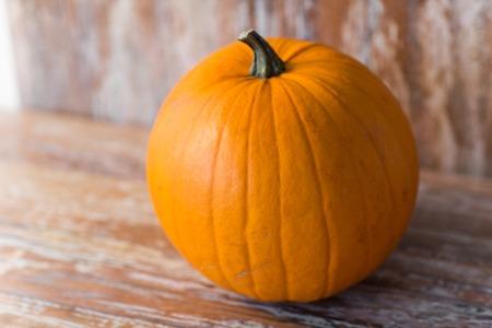 ripe pumpkin on wooden table Stock Photo