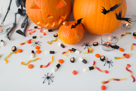 carved halloween pumpkins and candies Stock Photo