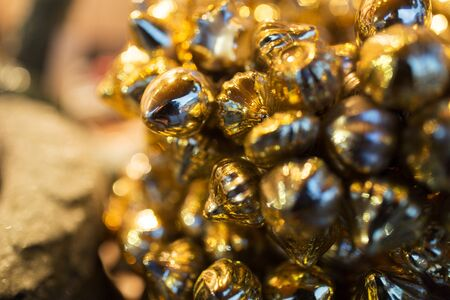 holidays and christmas concept - close up of golden decoration