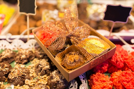 sale and food concept - craft sweets and cookies at christmas market stall