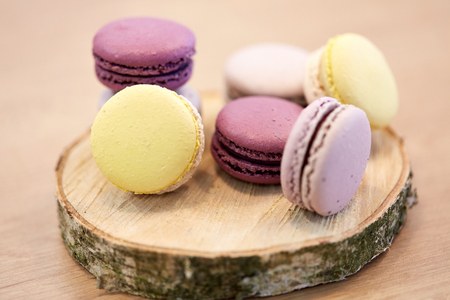 different macarons on wooden stand