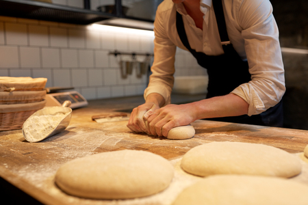 baker making bread dough at bakery kitchen