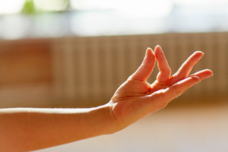 hand of meditating yogi woman showing gyan mudra