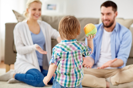 happy family playing with ball at home