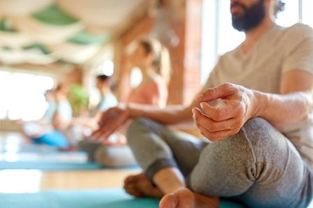 group of people making yoga exercises at studio Stock Photo - 87213365