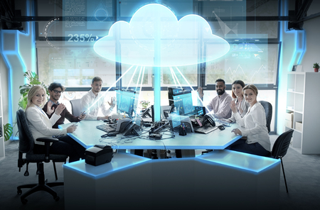 cloud computing, future technology and people concept - business team with computers waving hands at office