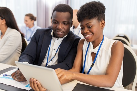 african business: team with tablet pc at business conference